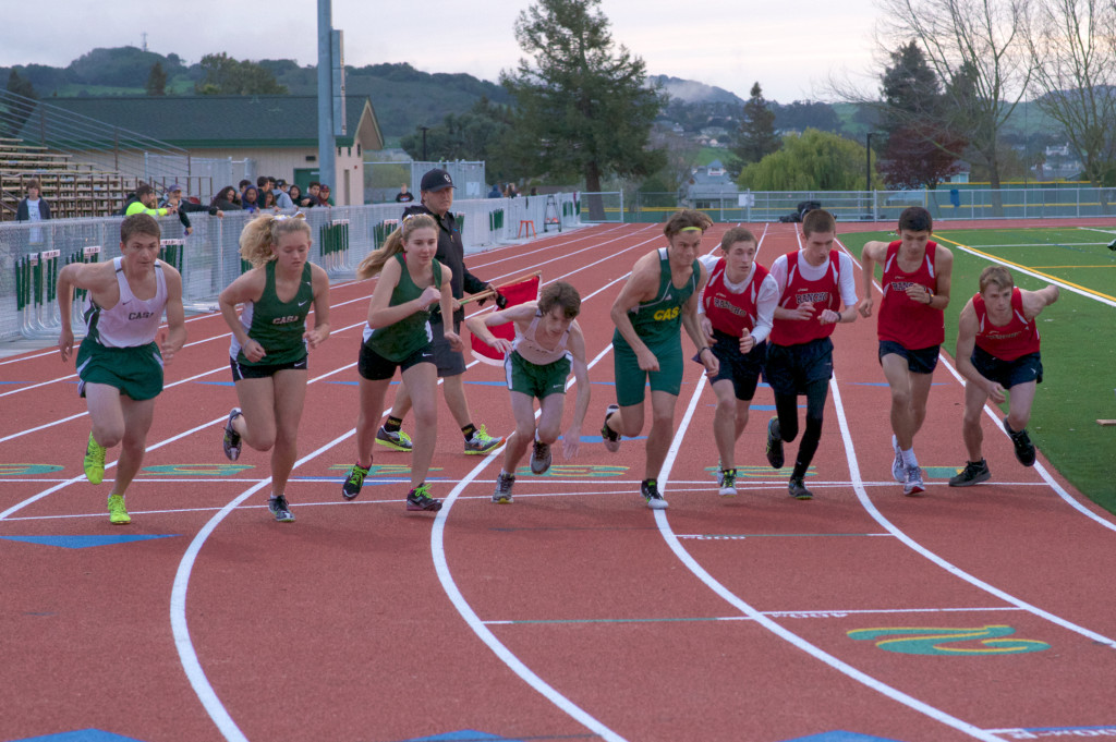 Start of the 3200 with Casa winners Scott Garrett, far left 10:42.0, and girls winner Siena Weigert, 3rd from left 12:11.3.